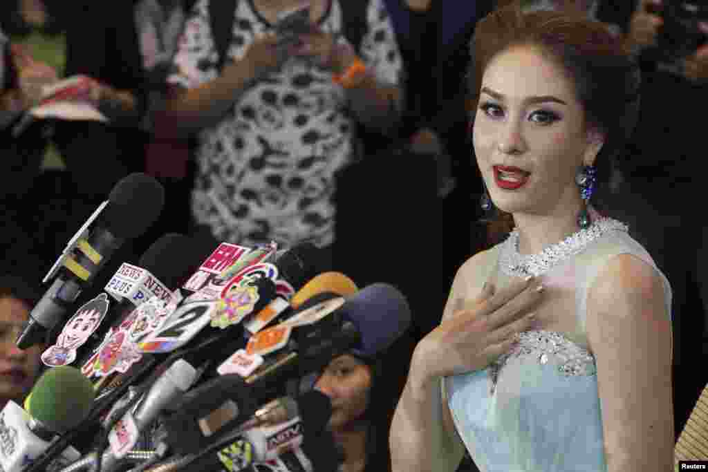 "Miss Universe Thailand Weluree Ditsayabut speaks during a news conference at Renaissance Hotel in Bangkok.  Ditsayabut renounced her title over remarks she made on social media including one that ""red shirt"" activists, supporters of ousted prime minister Yingluck Shinawatra, should all be executed."