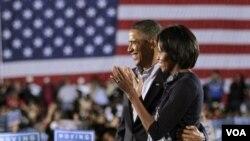 Presiden Obama dan Michelle Obama saat melakukan kampanye untuk menggalang dukungan pendukung Demokrat bagi pemilu sela 2 November mendatang.