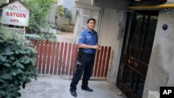 A Turkish police officer stands outside the house of American Pastor Andrew Craig Brunson, a 50-year-old evangelical pastor from Black Mountain, North Carolina, before his arrival, in Izmir, Turkey, July 25, 2018 after his release from a jail near Izmir.