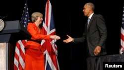 Britain's Prime Minister Theresa May (L) and U.S. President Barack Obama shake hands after speaking to reporters following their bilateral meeting alongside the G20 Summit, in Ming Yuan Hall at Westlake Statehouse in Hangzhou, China, September 4, 2016.