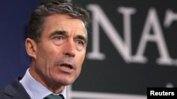 FILE - NATO Secretary-General Anders Fogh Rasmussen