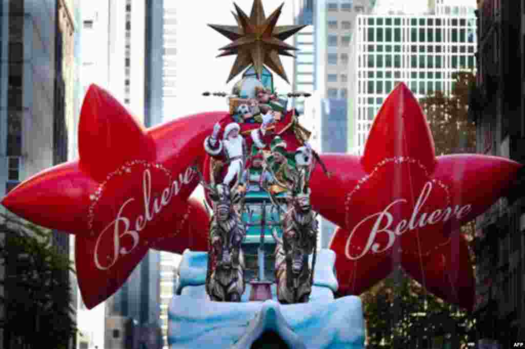 Santa Claus waves at spectators during the Macy's Thanksgiving Day Parade, Thursday, Nov. 24, 2011, in New York. A jetpack-wearing monkey and a freakish creation from filmmaker Tim Burton are two of the big new balloons that will make their inaugural appe