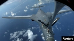 FILE - One of two U.S. Air Force B-1B Lancer bombers is being refueled over the East China Sea, Aug. 8, 2017.