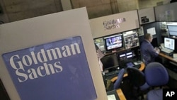 A trader works in the Goldman Sachs booth on the floor of the New York Stock Exchange, March 15, 2012.