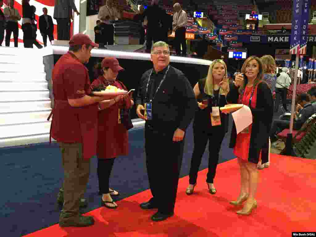 Concessions staff hand out cheese and grapes to those working on the floor of the Republican National Convention as workers prepare for Thursday night's prime-time schedule, which will include Donald Trump's acceptance speech, in Cleveland, July, 21, 2016
