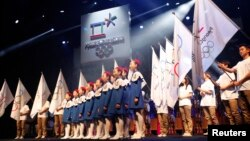 A choir sings as the emblem of the PyeongChang 2018 Olympic Winter Games is seen (top) during its Launch Ceremony in Seoul May 3, 2013. The official emblem of the 2018 PyeongChang Winter Olympic Games was unveiled on Friday.