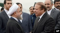 In this photo released by Press Information Department, Pakistan's PM Nawaz Sharif (R) receives visiting Iranian President Hassan Rouhani in Islamabad, Pakistan, March 25, 2016. This is Rouhani's first visit to Pakistan since taking office in 2013.