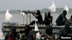 FILE - Militants are seen patrolling the creeks of the Niger delta region of Nigeria, Jan. 30, 2007. A key group, the Niger Delta Avengers, did not send representatives to Tuesday's talks.