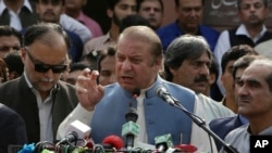 FILE - Nawaz Sharif addresses a crowd during his visit to a mausoleum of Pakistani poet Mohammad Iqbal on the occasion of Pakistan Independence Day in Lahore, Aug. 14, 2017.