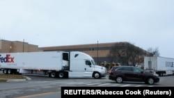 USA, Michigan, Portage, A FedEx truck leaves the Pfizer Global Supply.