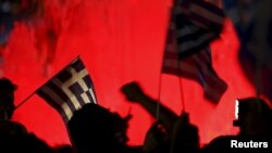 Greek national flags on the main Constitution (Syntagma) square in Athens, Greece July 5, 2015.