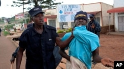 A supporter of opposition leader Kizza Besige is arrested during a rally on August 17, 2011 in memory of 10 people killed in a crackdown on protests in April
