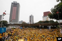 Activists from the Coalition for Clean and Fair Elections (BERSIH) gather on a main road in downtown Kuala Lumpur, Malaysia, during a rally, Aug. 30, 2015.