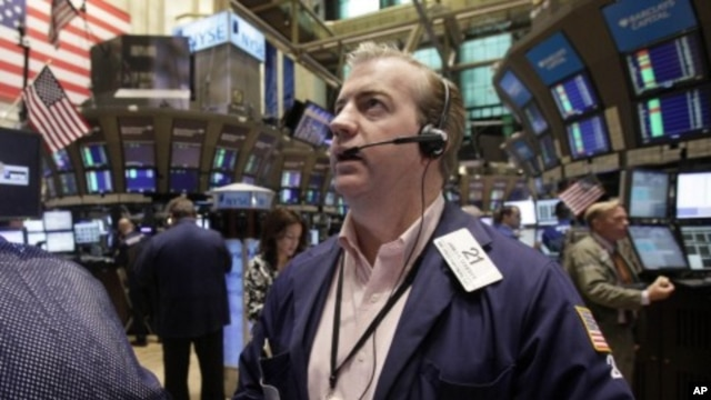 Trader James Doherty works on the floor of the New York Stock Exchange, August 12, 2011