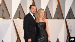 Leonardo DiCaprio, left, and Kate Winslet arrive at the Oscars on Feb. 28, 2016, at the Dolby Theatre in Los Angeles.