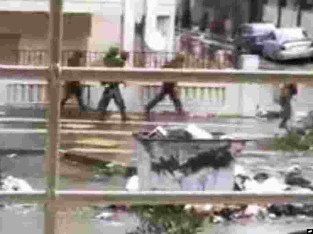 This image from amateur video purports to show Syrian forces in Homs, February 16, 2012. (AP/Shaam)