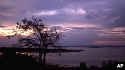 FILE - The sun sets over Lake George near Uganda's Queen Elizabeth National Park in western Uganda.
