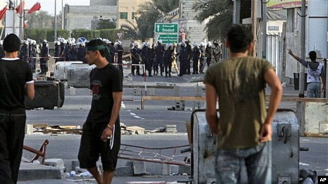 Bahraini riot police and soldiers move in on anti-government protesters March 25, 2011, in the western Shi'ite Muslim village of Malkiya, firing tear gas when villagers defied martial law by holding a protest march