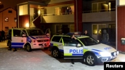 FILE - Swedish police are seen searching for terror suspects at a home in Boliden, northeastern Sweden, Nov. 19, 2015.