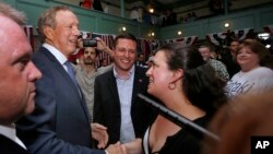Former New York Gov. George Pataki greets supporters in Exeter, New Hampshire, after announcing his plans to seek the Republican nomination for president, May 28, 2015.