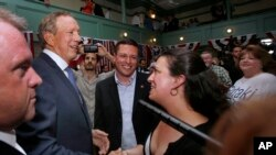 Former New York Gov. George Pataki greets supporters in Exeter, N.H., after announcing his plans to seek the Republican nomination for president, May 28, 2015.