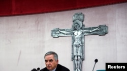FILE - Cardinal Giovanni Angelo Becciu, caught up in a real estate scandal, speaks to the media a day after he resigned, in Rome, Italy, Sept. 25, 2020. A trial is now underway at the Vatican involving Becciu and nine other defendants.
