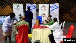 FILE - Kenyan tour guides and travel operators prepare to receive shots of the AstraZeneca coronavirus vaccine, under the COVAX program, in Nairobi, Kenya, April 27, 2021.