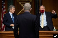 Senator Roy Blunt, R-Mo. and Sen. Lamar Alexander, R-Tenn., speak with Dr. Francis Collins, Director of the NIH, after he testified at a hearing on the plan to research, manufacture and distribute a coronavirus vaccine, known as Operation Warp Speed.