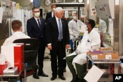 Vice President Mike Pence visits the molecular testing lab at Mayo Clinic Tuesday, April 28, 2020, in Rochester, Minn., where he toured the facilities supporting COVID-19 research and treatment.