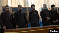 Five of seven men convicted of raping and robbing appear at a court in Kabul, Afghanistan, Sept. 7, 2014.