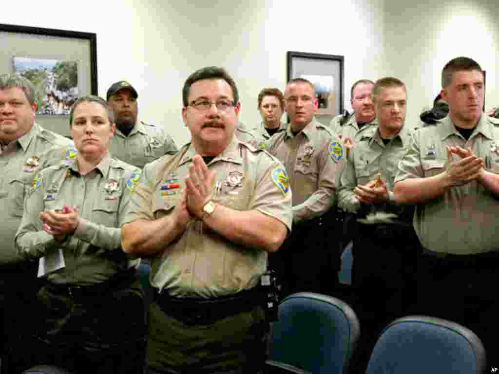 Immigration jail officers, who lost their federal power to check whether inmates are in the county illegally, give Sheriff Joe Arpaio a standing ovation after they turned in their credentials after federal officials pulled the Sheriff's office immigration