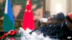 FILE - Djibouti's President Ismail Omar Guelleh, third from right, talks to his Chinese hosts (not pictured) during talks at the Great Hall of the People in Beijing, July 18, 2012.