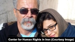 Sepideh Moradi, an Iranian Gonadabi dervish woman detained at Qarchak prison since February, appears in this undated photo with her father.