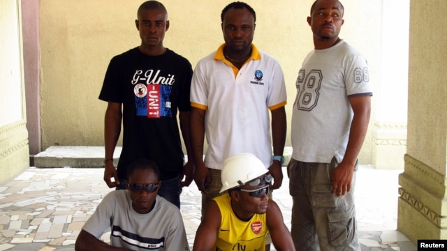 Ex-militants pose for a group photograph in Port Harcourt in the Niger Delta region, Nigeria, April 3, 2011.