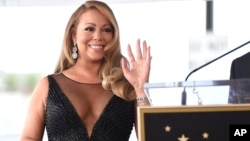 FILE - Mariah Carey attends a ceremony honoring her with a star on the Hollywood Walk of Fame in Los Angeles, Aug. 5, 2015.