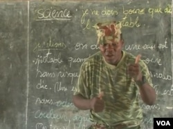 A Cameroonian soldier offers instruction at the government school in Fotokol, May 11, 2018. (M. Kindzeka/VOA)