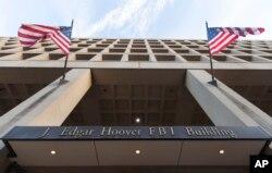 The Pennsylvania Avenue entrance of the J. Edgar Hoover Federal Bureau of Investigations (FBI) Building is seen in Washington, Nov. 30, 2017.