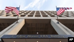 FILE - The Pennsylvania Avenue entrance of the J. Edgar Hoover Federal Bureau of Investigations (FBI) Building is seen in Washington, Nov. 30, 2017.