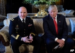 FILE - President Donald Trump listens as Army Lt. Gen. H.R. McMaster, the president's national security adviser, talks at Trump's Mar-a-Lago estate in Palm Beach, Fla, Feb. 20, 2017.