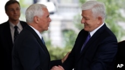 U.S. Vice President Mike Pence, left, shakes hands with Montenegro's Prime Minister Dusko Markovic after a meeting at the White House in Washington, June 5, 2017. Also on Monday, Montenegro formally became the 29th member of NATO during a State Department ceremony.