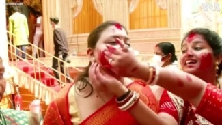 Women Smear Each Other With Vermillion to Culminate Durga Puja in India