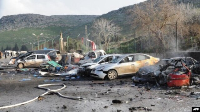 Remains of cars Feb. 11, 2013 at border between Turkey and Syria in Hatay, Turkey (ANADOLU AGENCY / CEM GENCO)
