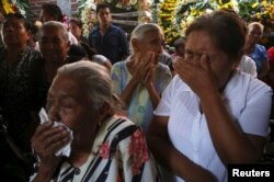Residents react during the funeral of newly-installed Temixco mayor Gisela Mota in Temixco, south of Mexico City, after Mota was shot dead on Saturday by four armed gunmen.