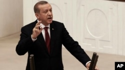 Turkey's President Recep Tayyip Erdogan addresses the parliament in Ankara, Turkey, on Oct. 1, 2016. Erdogan hinted on Thursday that the three-month state of emergency declared following the failed July 15 coup could be extended to more than a year.