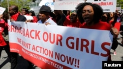 Protesters march in support of the girls kidnapped by members of Boko Haram in front of the Nigerian Embassy in Washington, D.C., May 6, 2014.