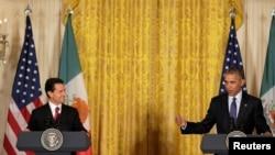 President Barack Obama and Mexican President Enrique Peña Nieto (L) speak at the White House in Washington, July 22, 2016. REUTERS/Joshua Roberts