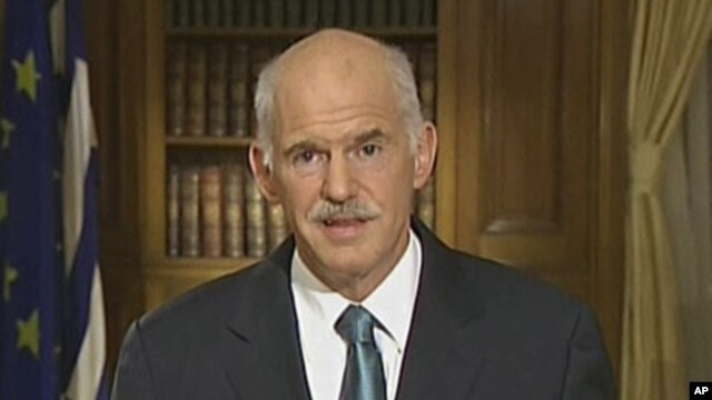 In this image taken from TV, Greek Prime Minister George Papandreou, talks to the nation in a live TV broadcast, June 15, 2011, in Athens