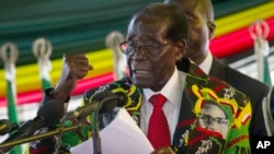 FILE: Zimbabwe President Robert Mugabe delivers his speech at the opening session of his party's 16th Annual Peoples Conference in Masvingo, about 300 kilometres, south of the capital Harare, Friday Dec. 16, 2016.