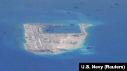 Chinese dredging vessels are purportedly seen around Fiery Cross Reef in the disputed Spratly Islands in the South China Sea.