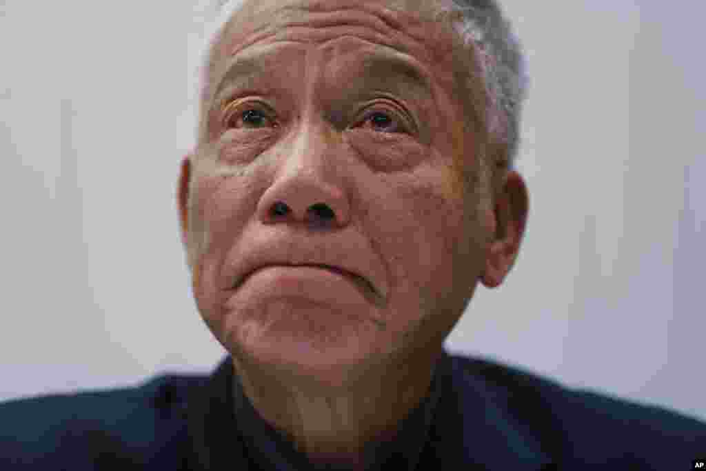 One of three protest leaders, Reverend Chu Yiu-ming,  weeps as he announces that he and two other pro-democracy leaders will surrender to police, during a news conference, in Hong Kong, Dec. 2, 2014.